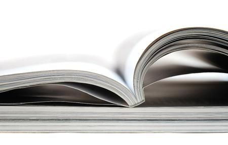 magazine stack: Magazines isolated on white background