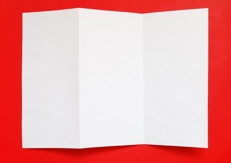 Folded paper on red background, top view Stock Photo - 12498906