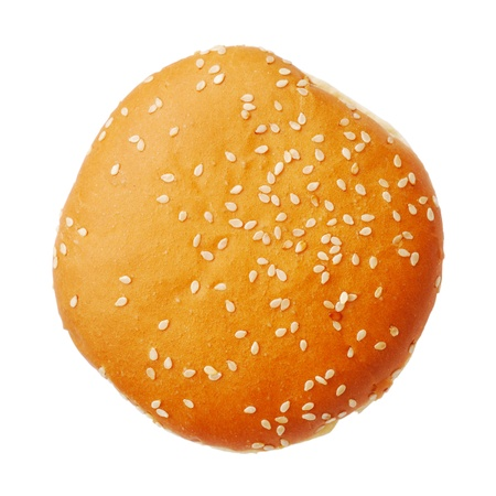 burger background: Bun with sesame isolated on white background, top view Stock Photo
