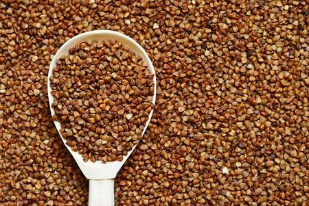 groat: Buckwheat in the wooden spoon