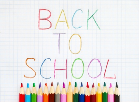 Colored pencils and back to school text photo