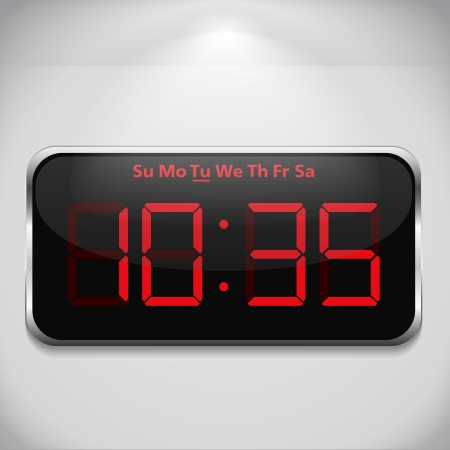 Digital clock on gray wall