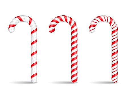 Three candy canes on white background
