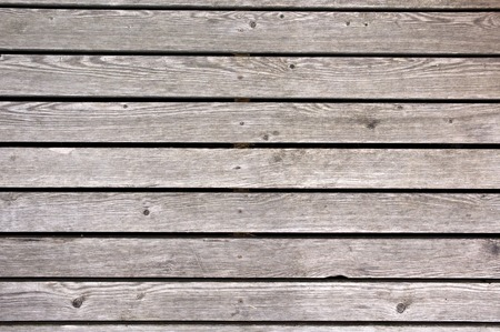 Horizontal wooden plates left outside for years. After that they got this grey color. photo