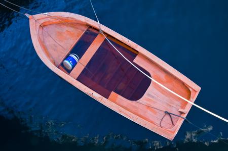 sunken boat: An old oared boat sunken in the water.  Stock Photo