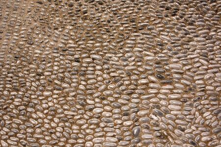 The pebble pavement of ancient Olinthus, Pella and Rhodes.