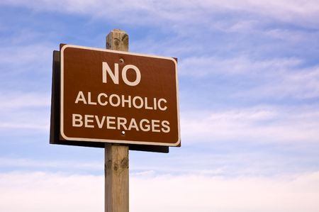 single word: No alcoholic beverages sign, commonly seen in the public areas.