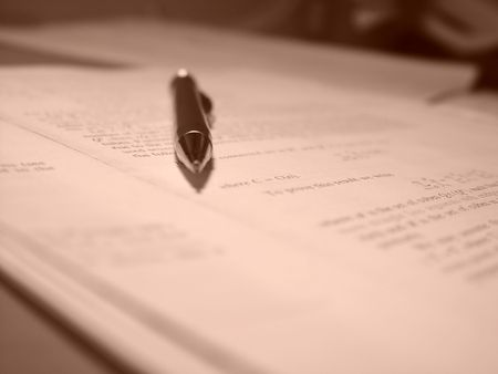 articles: Mathematical paper with a pencil on it. Sepia toning. Shallow depth of field.