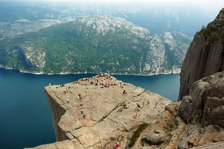 Preikestolen or Prekestolen, also known by the English translations of Preachers Pulpit or Pulpit Rock is a massive cliff 604 metres above Lysefjorden. It is a famous tourist attraction in Norway.