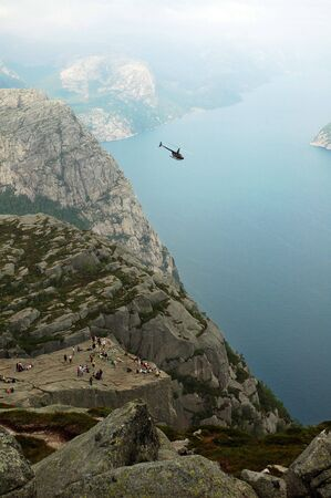 english famous: Preikestolen or Prekestolen, also known by the English translations of Preachers Pulpit or Pulpit Rock is a massive cliff 604 metres above Lysefjorden. It is a famous tourist attraction in Norway.