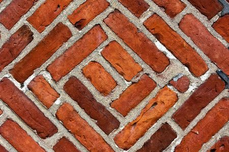 A close up of an old scratched red brick wall. Stock Photo