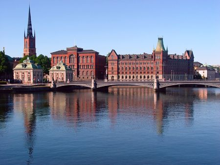 Stockholm, Sweden. The Vasa Bridge to Gamla stan over Norrström, with the Riddarholmen Church tower in the back.