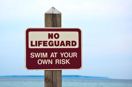No lifeguard. Swim at your own risk  sign.