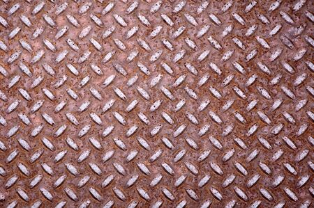 Old rusty steel floor plate. Diamond shaped. photo