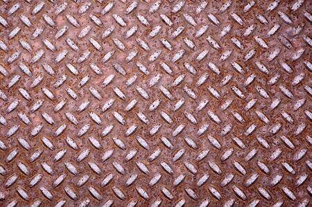diamond shaped: Old rusty steel floor plate. Diamond shaped.