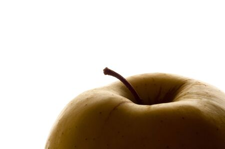 Upper part of an Apple. Isolated on white. Side lit to reveal the shape. Stock Photo