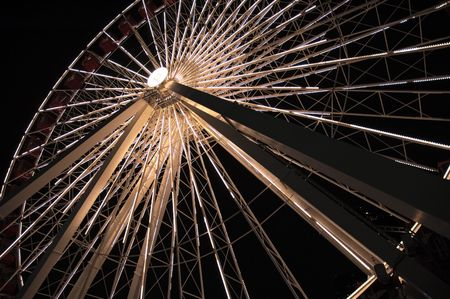 Lighted ferris wheel in the night