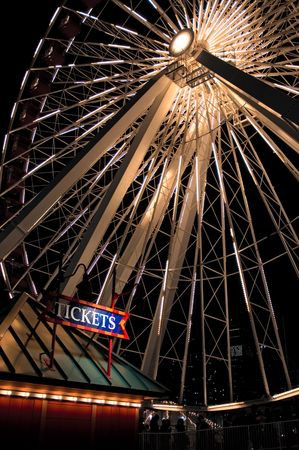 a ticket booth infront of a huge ferris wheel Stock Photo
