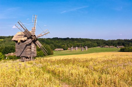 Old wooden windmill in the countryside