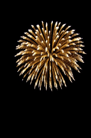 A spherical break of stars. Firework rocket. Isolated on a black background. Stock Photo