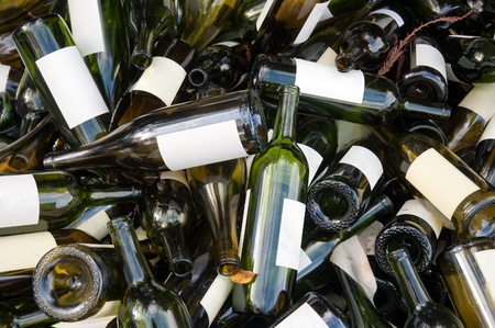 drink responsibly: A large heap of empty green wine bottles