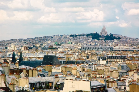 A view from the Centre Georges Pompidou towards 9th, 10th and 18th arrondissements with Sacre Coeur and Paris roofs  photo