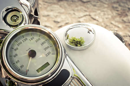 White speedometer on old cllasic motorcycle photo