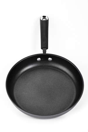 Front view of black and white frying pan isolated on white background Stock Photo - 17940085
