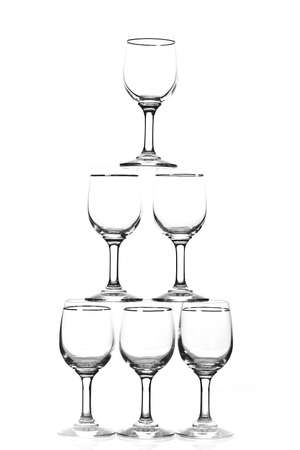 Group of empty wine glass. Isolated on a white background. Black and white image. photo
