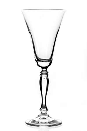 sherry: Single empty wine glass. Isolated on a white background. Black and white image.