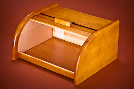 wooden bread box on brown backgroud photo