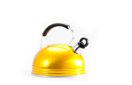 Yellow tea kettle isolated on white background photo