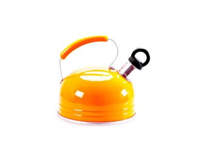Orange  tea kettle isolated on white background photo