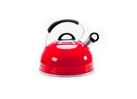 Red  tea kettle isolated on white background photo
