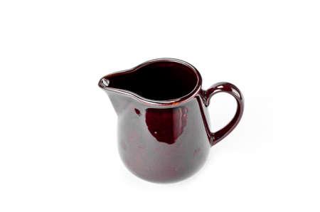 Old ceramic jug isolated on white background photo