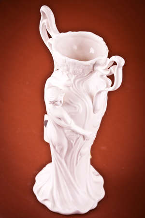 Old ceramic jug on brown  background photo