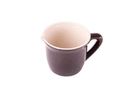 robustness: A pottery pitcher of milk on white background Stock Photo