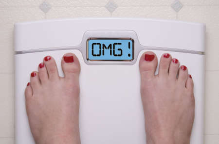 Digital Bathroom Scale Displaying OMG Message photo