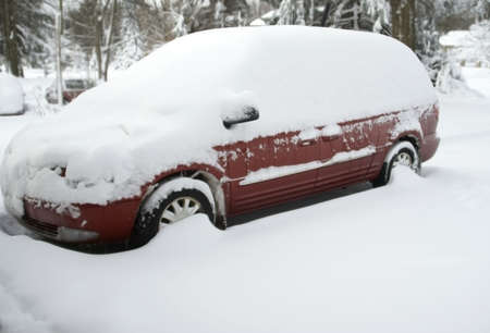 A parked van covered in snow parked in a residential driveway Stock Photo - 7936409