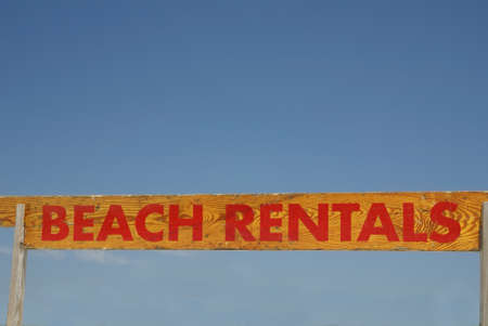 rentals: A wooden hand painted sign saying Beach Rentals