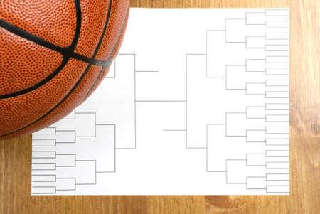 A blank basketball tournament bracket and a basketball Imagens