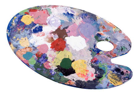 A paint covered artist's palette on white background Stock Photo - 9166580