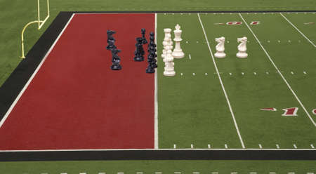 Chess pieces lined up like football teams on the goal line