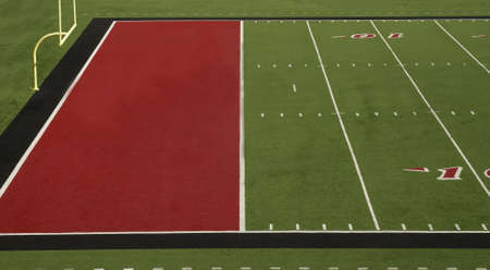 A football field with a red endzone photo