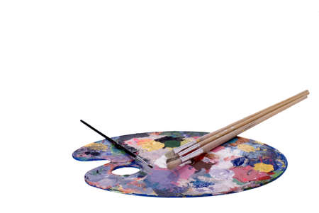 painter palette: An artists palette and paint brushes