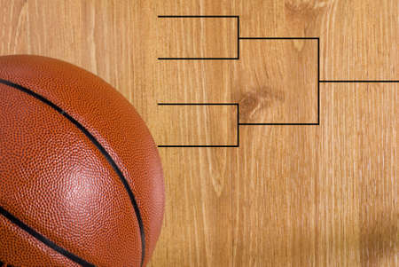 A final four bracket on a basketball floor and a ball photo