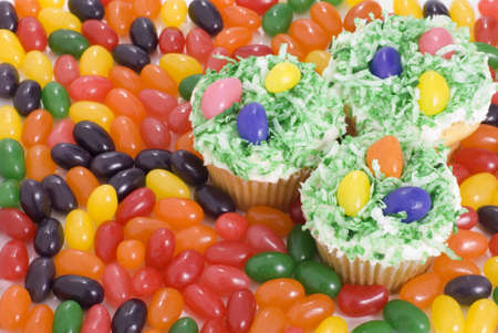Easter cupcakes surrounded by colorful jelly beans Stock Photo