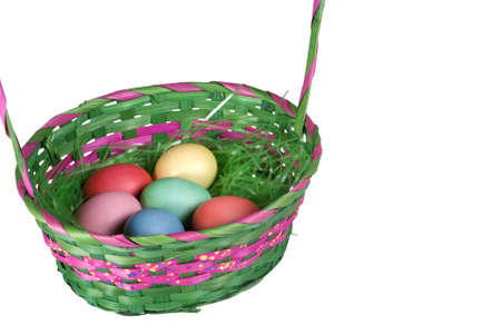 Six colored Easter eggs in a colorful Easter basket photo