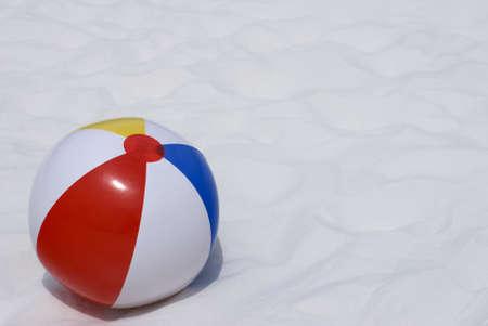 A colorful beach ball on a sugar white sand beach Stock Photo