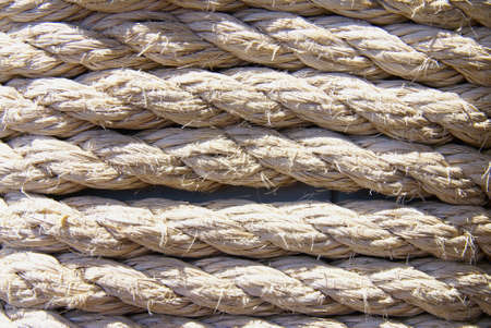 Close up shot of a weathered nautical rope  photo
